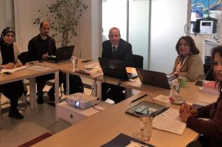 Representatives from Arab EMBs and the UNDP-Arab States Regional Electoral Assistance Project sitting around a table during a meeting organized by International IDEA in Tunis