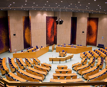 Plenary Hall of the Second Chamber at the Dutch Parliament. Photo Credit: Jeroen Van Luin Flickr.