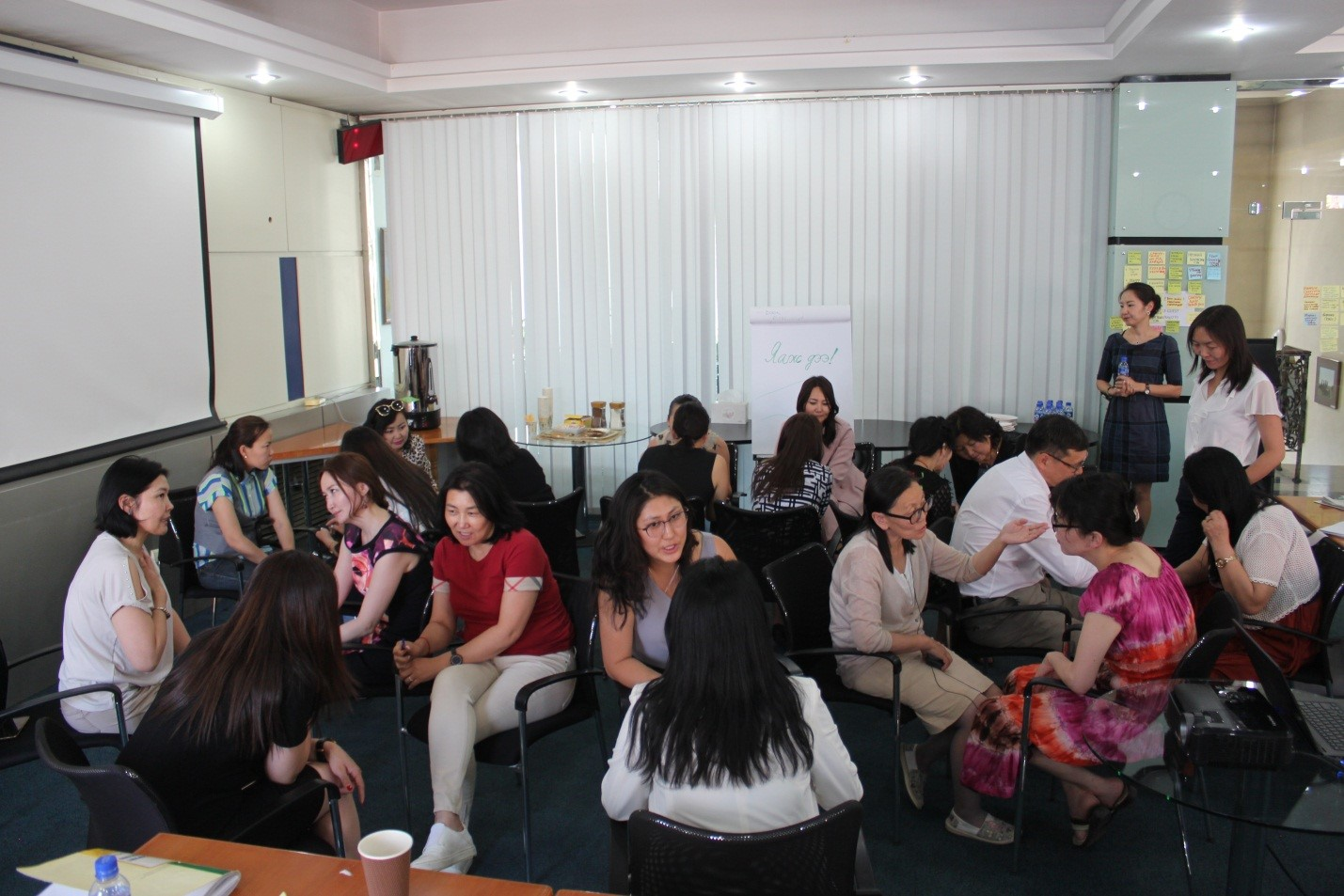 Reaching across the aisle: Women from opposing political parties sit together to discuss common challenges and ways to improve inclusiveness of political process in Mongolia in June 2018. Photo: BRIDGE workshop.