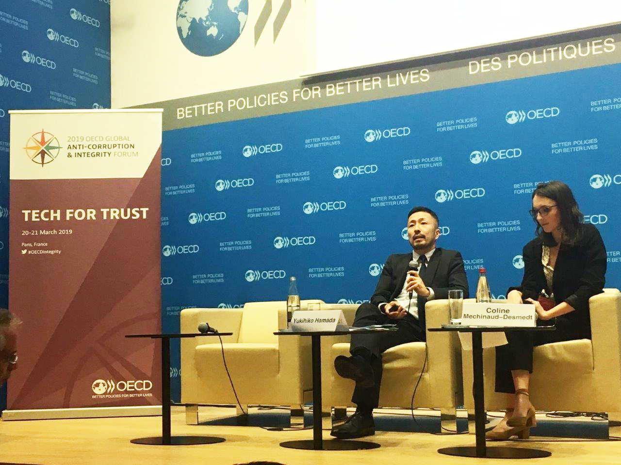 Yukihiko Hamada, at left, during OECD's annual Global Anti-Corruption and Integrity Forum, March 2019.  International IDEA and the United Nations Office on Drugs and Crime (UNODC), provided an extensive overview of cryptocurrencies' policy implications at the Forum. Photo credit: OECD.