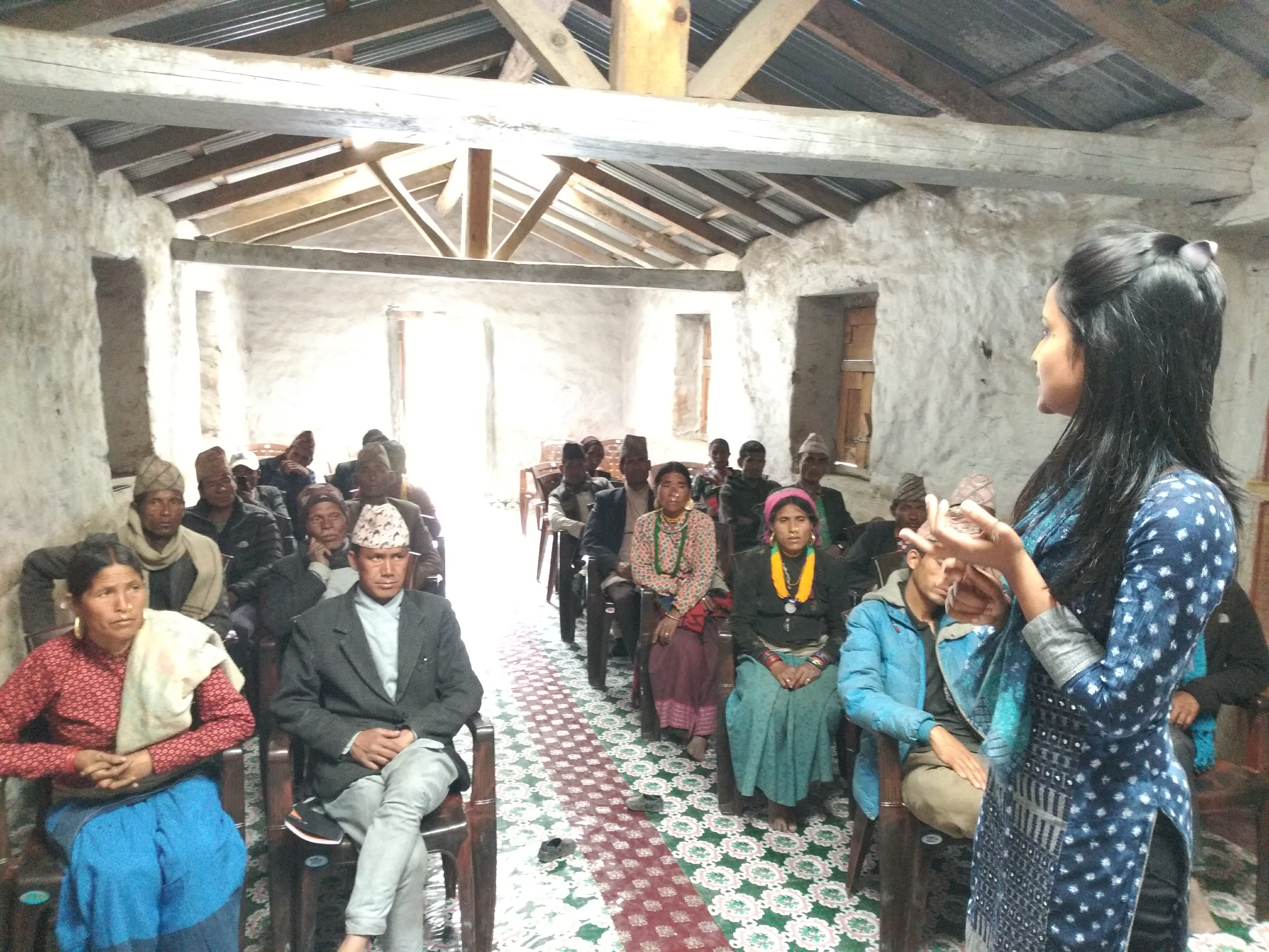A mentor of International IDEA's Coherence programme explaining the elected representatives of a Adanchuli Gaunpalika (rural municipality) of Nepal's Karnali Province about the importance of their Gaunpalika's strategic vision in annual planning.  Photo credit: International IDEA