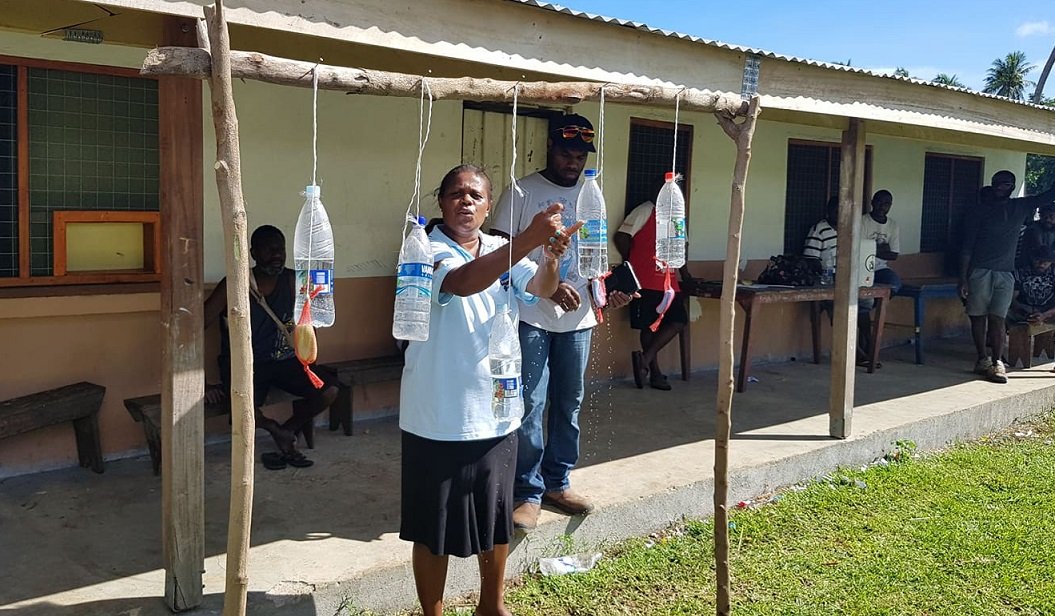 On the Election Day (19 March 2020) voters were made to wash their hands before casting ballots in a polling station on Malekula Island as a precaution against COVID-19. Health workers are seen working with election officials in explaining how the hand washing should be done. Image credit: the MSG Secretariat.