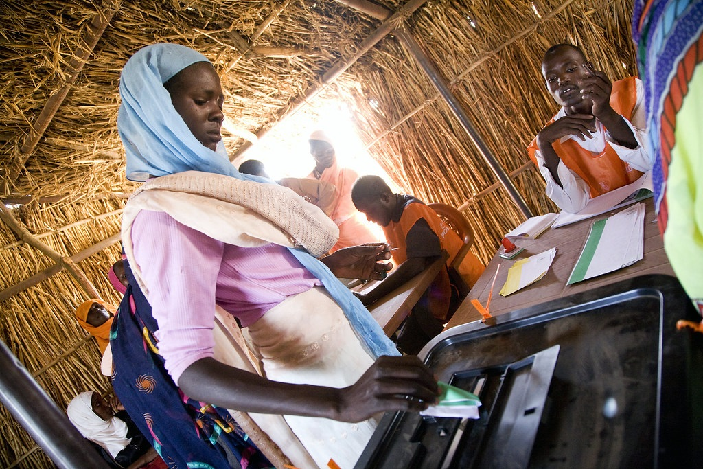 """""""North Darfur Woman Votes in Sudanese National Elections"""" by United Nations Photo is licensed under CC BY-NC-ND 2.0"""