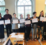 Participants show text from Article 21 of the Universal Declaration of Human Rights after completing an activity. Photo Credit; International IDEA