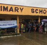 Voters queue to cast their ballots in Fiji early in the day, despite the rain. Image credit: Adhy Aman/International IDEA
