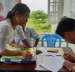 Participant registers for International IDEA-run training on poll monitoring. Image Credit: International IDEA Myanmar