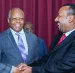 Prime Minister Abiy Ahmed with opposition leaders Beyene Petros, shaking hands, and Merera Gudina. Image credit: Ethiopia Insight