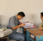 Polling officers going through the voters list collected with the Electronic Voting Machines (EVM).