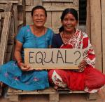 "Two women in Nepal hold a sign reading, ""Equal?""  Video still by Stephan Bachenheimer/World Bank."