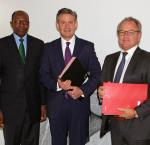 From left: H.E. Dr. Kaire Munionganda Mbuende, Ambassador of the Republic of Namibia to the Kingdoms of Belgium and the Netherlands, the Grand Duchy of Luxembourg, and Mission to the European Union; Andrew Bradley, Director of the Office of International IDEA to the European Union; Carl Michiels, Chairman of the Management Committee of the BTC at a signing ceremony between the BTC and International IDEA on 4 OCtober 2017