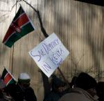 "Protest sign reading ""Save democracy in Kenya"""