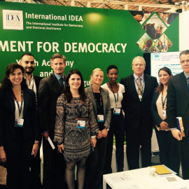 Opening ceremony of the International IDEA stand, group picture with International IDEA staff, H.E. Mr. Gonzalo Gutiérrez, Ambassador of Peru in Brussels,Mr. Hamed Zekri, Councellor at the Embassy of Tunisia in Brussels, and stand visitors.
