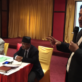 Dipendra Jha introducing draft bill to the members of parliament and civil society actors