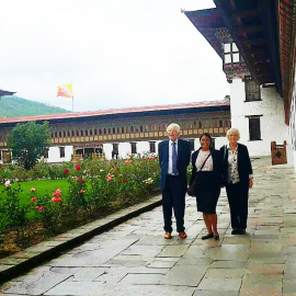 Lord Bryan Davies of Oldham, Ms Davies and Sinead Nicola Jayawickreme inside the Tashischho Dzong. Photo Credit: Pema Yangzome